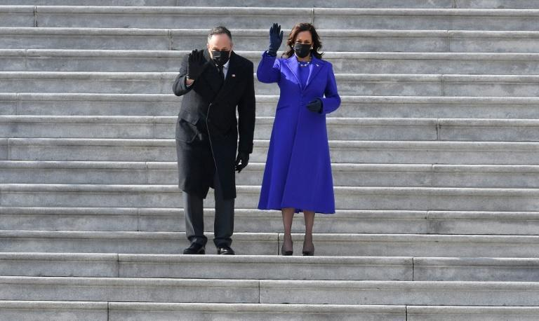 Vice President Kamala Harris and her husband US Second Gentleman Doug Emhoff wave as former US Vice President Mike Pence and his wife Karen Pence leave after the inauguration of Joe Biden as the 46th US President January 20, 2021, at the US Capitol