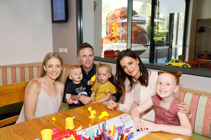 A photo of actor Katie Holmes and the Cantrill family at Ronald McDonald House Westmead.