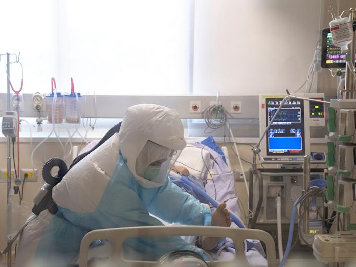 FILE PHOTO: An ICU nurse wearing personal protection equipment (PPE) takes care of a COVID-19 patient in the intensive care unit at the King Chulalongkorn Memorial Hospital in Bangkok, Thailand, April 23, 2020.  REUTERS/Athit Perawongmetha