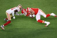 MIAMI, FLORIDA - FEBRUARY 02: Travis Kelce #87 of the Kansas City Chiefs is tackled by Emmanuel Moseley #41 of the San Francisco 49ers during the second quarter in Super Bowl LIV at Hard Rock Stadium on February 02, 2020 in Miami, Florida. (Photo by Elsa/Getty Images)