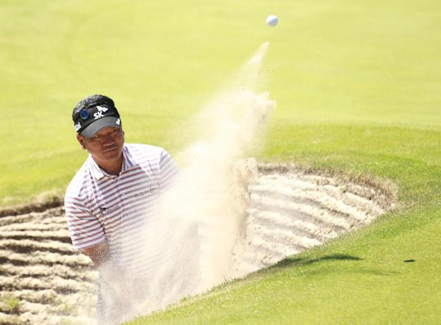 KJ Choi of Korea plays out of a bunker on the 15th hole during a practice round ahead of the British Open Golf championship at the Royal Liverpool golf club, Hoylake, England, Tuesday July 15, 2014. The British Open Golf championship starts Thursday July 17. (AP Photo/Peter Mossison)
