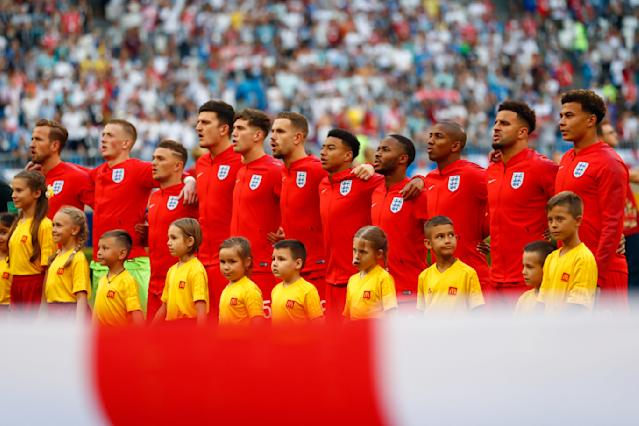 FILE - In this Saturday, July 7, 2018 file photo England national soccer team players stand prior to the start of the quarterfinal match between Sweden and England at the 2018 soccer World Cup in the Samara Arena, in Samara, Russia. (AP Photo/Matthias Schrader )