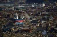 In this March 28, 2011, file photo, a ship sits in a destroyed residential neighborhood in Kesennuma, Miyagi Prefecture, northeastern Japan, after a powerful tsunami hit the area on March 11. (AP Photo/David Guttenfelder, File)