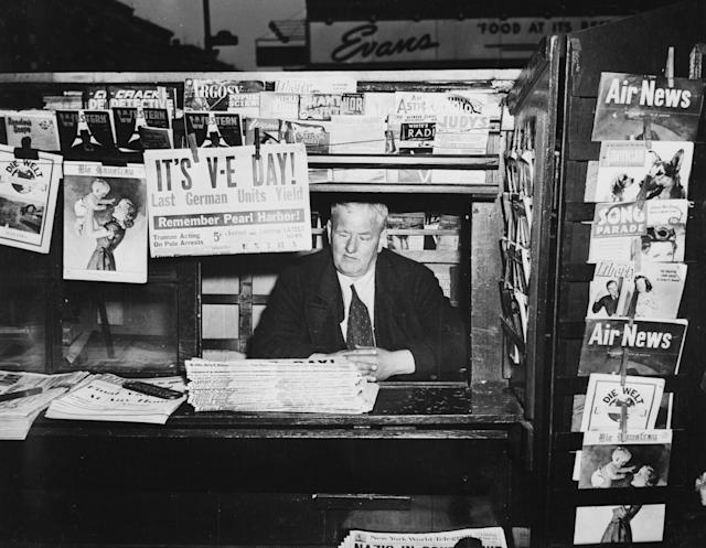 May 1945: A publication at a news-stand in America announces the surrender of the last German units on V-E Day, signalling Victory in Europe. (Photo by Weegee(Arthur Fellig)/International Center of Photography/Getty Images)