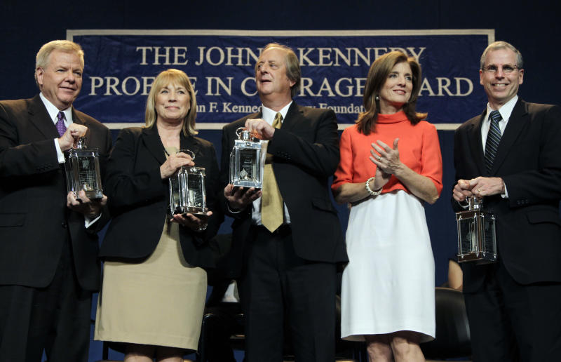 Caroline Kennedy, second from right, applauds as the recipients of the 2012 John F. Kennedy Profile in Courage Awards hold their lanterns at the JFK Library in Boston, Monday, May 7, 2012. From left are Michael Streit, former Iowa Supreme Court Justice; Marsha Ternus, former Iowa Supreme Court Chief Justice; David Baker, former Iowa Supreme Court Justice; and Robert Ford,  U.S. Ambassador to Syria. (AP Photo/Elise Amendola)