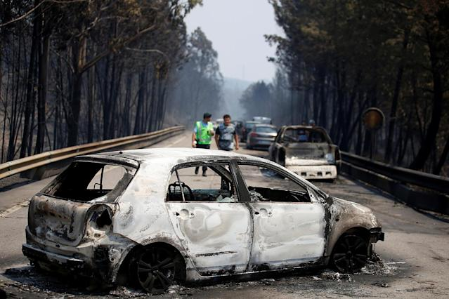 <p>Burned out cars are seen in Figueiro dos Vinhos, Portugal, June 18, 2017. At least 62 people have been killed in forest fires in central Portugal, many of them trapped in their cars as flames swept over a road Saturday evening. (Rafael Marchante/Reuters) </p>