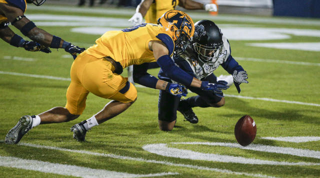 Utah State's Jordan Nathan, right, fumbles on a kick return as Kent State's Elvis Hines (8) recovers the ball during the first half of the Frisco Bowl NCAA college football game Friday, Dec. 20, 2019, in Frisco, Texas. (AP Photo/Brandon Wade)
