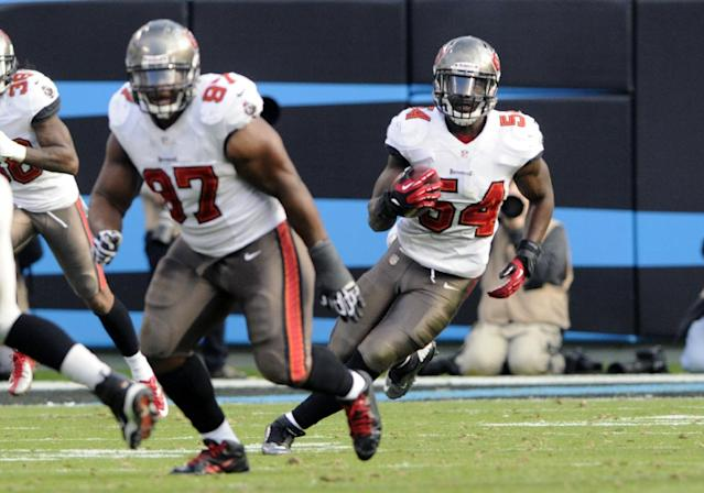 Tampa Bay Buccaneers' Lavonte David (54) returns an interception against the Carolina Panthers in the second half of an NFL football game in Charlotte, N.C., Sunday, Dec. 1, 2013. (AP Photo/Mike McCarn)