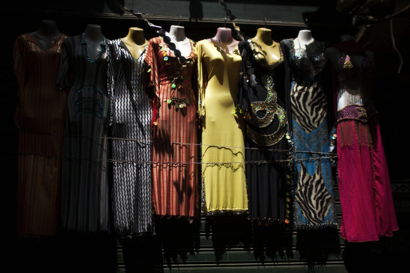 Mannequins and dresses are seen on an empty street in the Khan El-Khalili market, normally a popular tourist destination, in Cairo, Egypt, Wednesday, Aug. 21, 2013. Riots and killings that erupted across the country after the crackdown against followers of ousted President Mohammed Morsi have delivered a severe blow to Egypt's tourism industry, which until recently accounted for more than 11 percent of the country's gross domestic product and nearly 20 percent of its foreign currency revenues. (AP Photo/Manu Brabo)