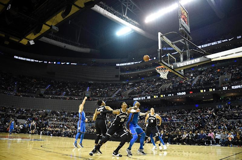 Oklahoma City Thunder and Brooklyn Nets players compete for the ball during a NBA Global Games match at the Mexico City Arena