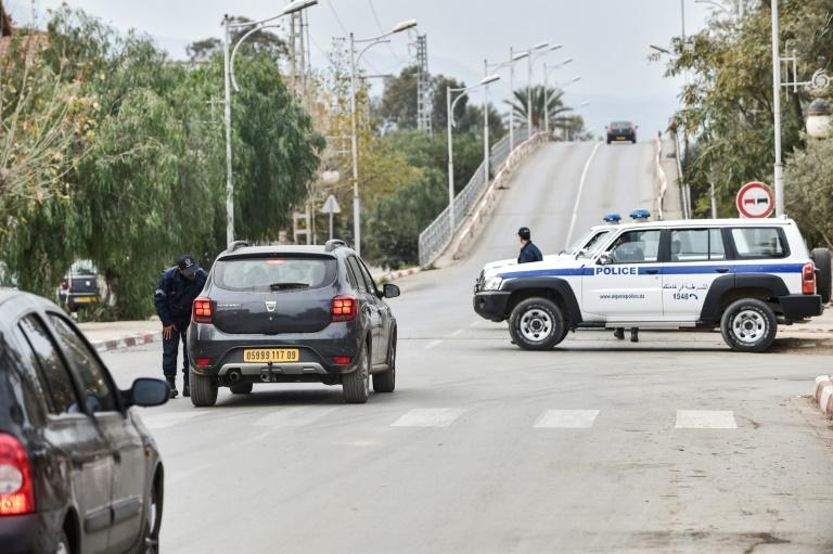 Police cars block access to a road near a courthouse in the Algerian city of Blida where the appeal hearing was held (AFP Photo/RYAD KRAMDI                        )