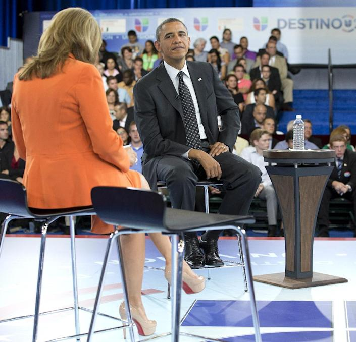President Barack Obama participates in a town hall hosted by Univision and Univision news anchor Maria Elena Salinas, left, at the University of Miami, Thursday, Sept. 20, 2012, in Coral Gables, Fla. (AP Photo/Carolyn Kaster)