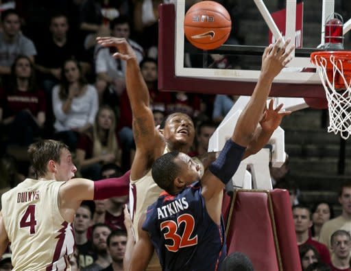 Florida State's Xavier Gibson, rear, rejects a dunk attempt by Virginia's Darion Atkins (32) during the first half of an NCAA college basketball game on Saturday, Feb. 4, 2012, in Tallahassee, Fla. (AP Photo/Phil Sears)