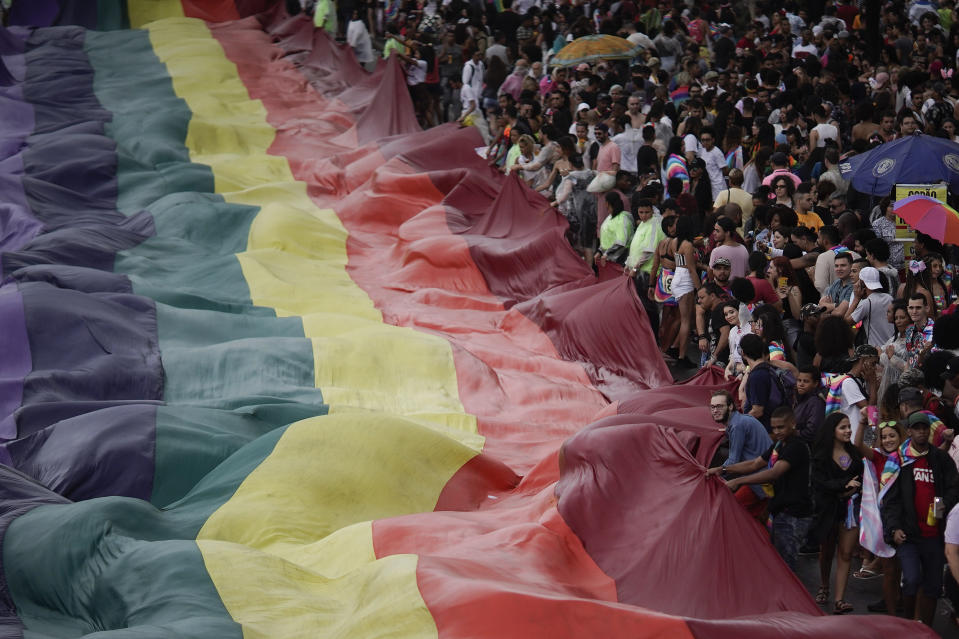 People carry a giant gay pride flag during during the annual pride parade along Copacabana beach in Rio de Janeiro, Brazil, Sunday, Sept. 22, 2019. The 24th gay pride parade titled this year's parade: