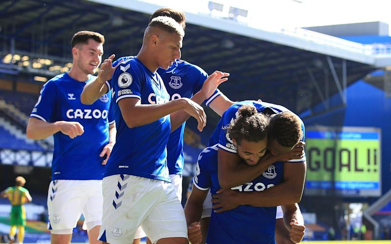 Dominic Calvert-Lewin of Everton celebrates scoring their 5th goal with Richarlison and Yerry Mina during the Premier League match between Everton and West Bromwich Albion at Goodison Park on September 19, 2020 in Liverpool - Getty Images