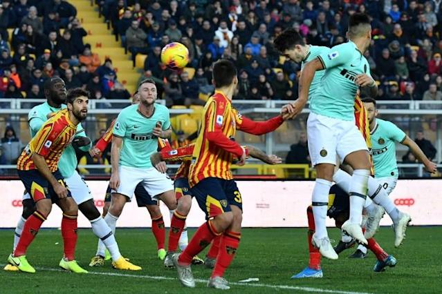 Alessandro Bastoni heads Inter in front against Lecce -- but Antonio Conte's side were held to a potentially damaging 1-1 draw (AFP Photo/Tiziana FABI )