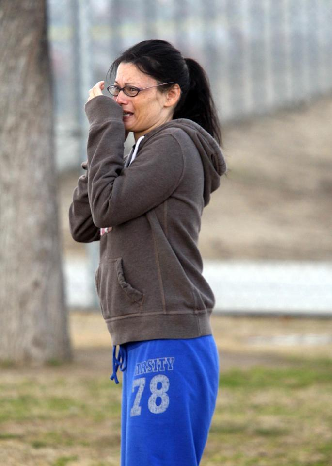 A unidentified woman cries while standing outside Taft Union High School after a shooting on Thursday, Jan. 10, 2012 in Taft, Calif. The sheriff of Kern County, Calif., says a 16-year-old student shot at a high school is in critical but stable condition. Sheriff Donny Youngblood says the shooter is a student who walked into a class at Taft Union High School Thursday morning and shot the teen with a shotgun, and then fired at another student but missed. A teacher suffered a minor pellet wound to the head. Youngblood says the teacher tried to get other students out a back door, then he and another staff member engaged the shooter in conversation to distract him, and convinced him to put down the gun. (AP Photo/The Bakersfield Californian, Alex Horvath) MANDATORY CREDIT; MAGS OUT; NO SALES; ONLINE OUT; TV OUT