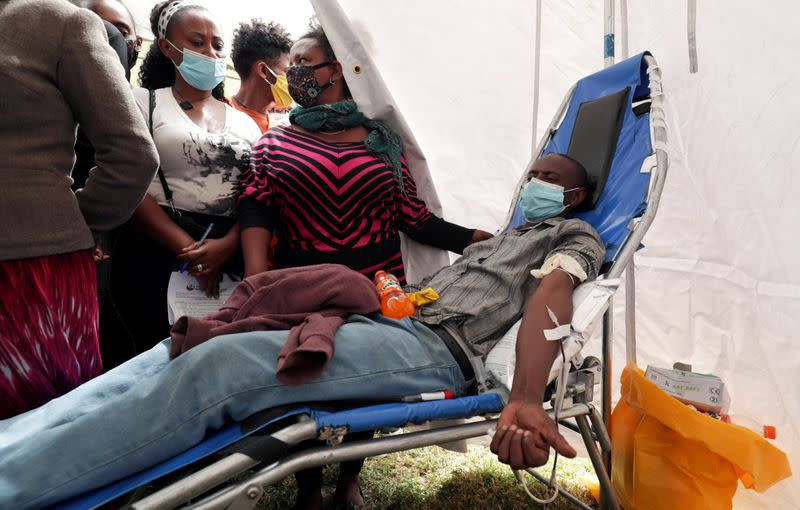 FILE PHOTO: A volunteer donates blood for the injured members of Ethiopia's National Defense Forces (ENDF), at the stadium in Addis Ababa