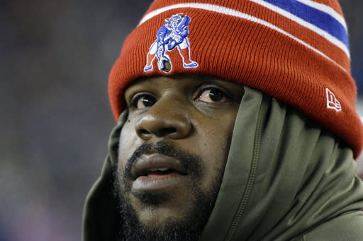 Injured New England Patriots defensive tackle Vince Wilfork watches in the second quarter of an NFL football game between the Patriots and the Denver Broncos Sunday, Nov. 24, 2013, in Foxborough, Mass. (AP Photo/Stephan Savoia)