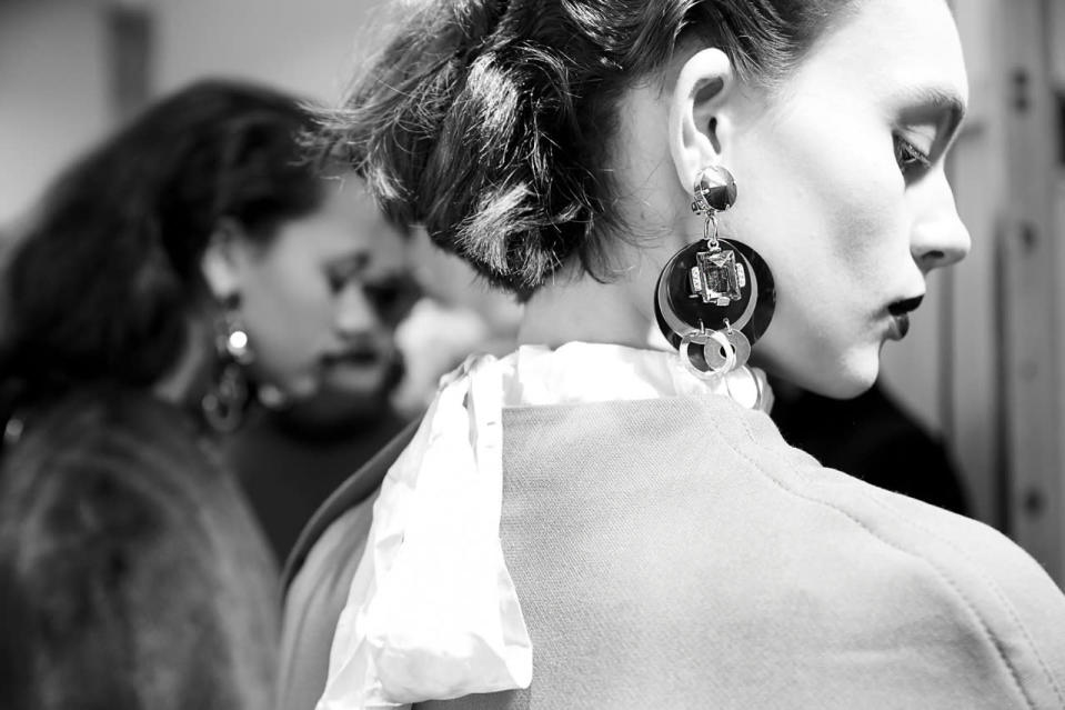 <p>Model Ondria Hardin waits for her cue to hit the catwalk.</p>