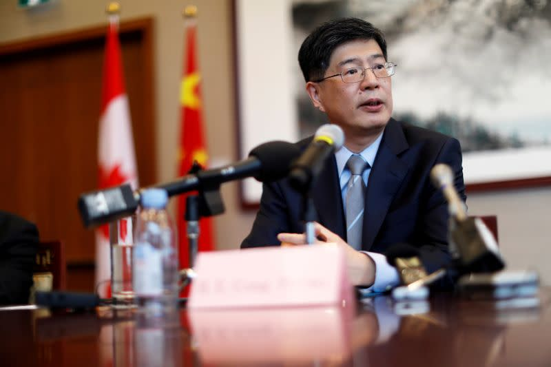FILE PHOTO: China's new ambassador to Canada Cong Peiwu speaks during a news conference for a small group of reporters at the Chinese Embassy in Ottawa