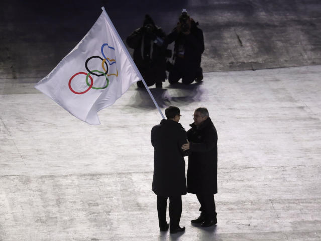 International Olympic Committee President Thomas Bach, right, hands the Olympic flag to the mayor of Beijing Chen Jining, during the closing ceremony of the 2018 Winter Olympics in Pyeongchang, South Korea, Sunday, Feb. 25, 2018.(AP Photo/Aaron Favila)