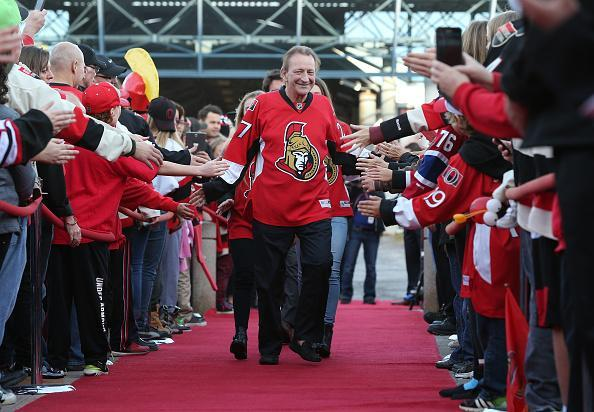 OTTAWA, ON - OCTOBER 11: Eugene Melnyk, owner of the Ottawa Senators, high-fives fans as he walks down the red carpet before the home opener against the Montreal Canadiens at Canadian Tire Centre on October 11, 2015 in Ottawa, Ontario, Canada. (Photo by Andre Ringuette/NHLI via Getty Images)