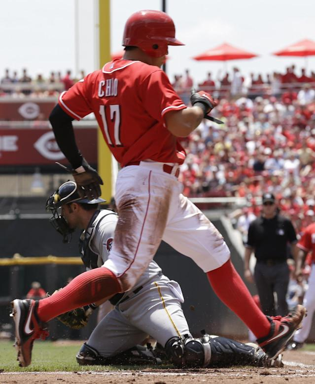 Cincinnati Reds' Shin-Soo Choo scores on a hit by Joey Votto as Pittsburgh Pirates catcher Michael McKenry is pulled off the plate by a wide throw in the first inning of a baseball game, Thursday, June 20, 2013, in Cincinnati. (AP Photo/Al Behrman)
