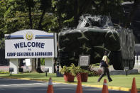 A woman walks inside Camp Aguinaldo military headquarters where U.S. Marine Lance Cpl. Joseph Scott Pemberton is held in Quezon city, Philippines on Thursday Sept. 3, 2020. A Philippine court has ordered the early release for good conduct for Pemberton who was convicted in the 2014 killing of transgender Filipino Jennifer Laude which sparked anger in the former American colony. (AP Photo/Aaron Favila)