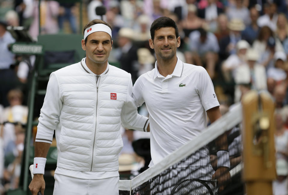 FILE - Switzerland's Roger Federer, left, and Serbia's Novak Djokovic poses before the men's singles final match of the Wimbledon Tennis Championships in London, in this Sunday, July 14, 2019, file photo. The draw to set up the singles brackets for this year's Wimbledon will be held Friday, June 25, 2021. Play begins Monday. (AP Photo/Tim Ireland, File)