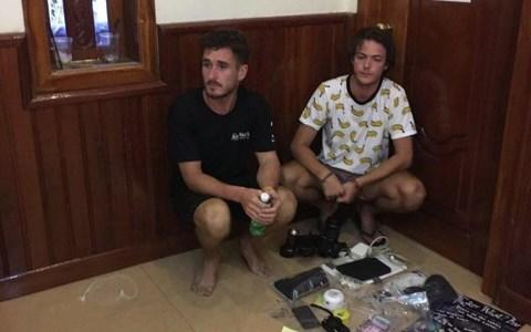Two of the British tourists who were detained - Credit: Cambodia Police