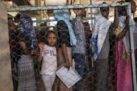 Queueing for aid: For some, life in the camp is all they have known