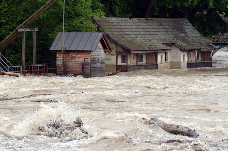 The river Rhine floods buildings near Rheinfelden, southern Germany, Sunday, June 2,2013. Heavy rainfalls cause flooding along rivers and lakes in Germany, Austria, Switzerland and the Czech Republic. (AP Photo/dpa, Patrick Seeger)