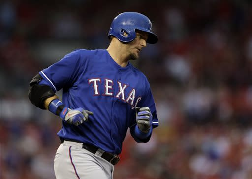 Texas Rangers' A.J. Pierzynski rounds the bases after hitting a two-run home run during the second inning of a baseball game against the St. Louis Cardinals on Saturday, June 22, 2013, in St. Louis. (AP Photo/Jeff Roberson)