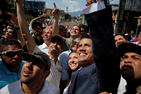 Venezuelan opposition leader and self-proclaimed interim president Juan Guaido and opposition leader Henrique Capriles attend a rally against Venezuelan President Nicolas Maduro's government in Caracas, Venezuela February 2, 2019. REUTERS/Carlos Barria