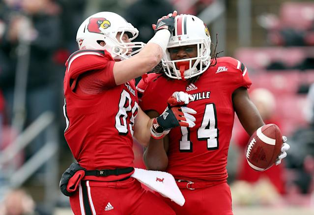 LOUISVILLE, KY - NOVEMBER 03: Scott Radcliff #89 and Andrell Smith #14 of the Louisville Cardinals celebrate after Smith caught a touchdown pass during the game against the Temple Owls at Papa John's Cardinal Stadium on November 3, 2012 in Louisville, Kentucky. (Photo by Andy Lyons/Getty Images)