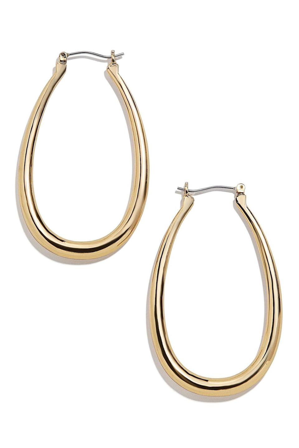 """<p><strong>Baublebar</strong></p><p><strong>$36.00</strong></p><p><a href=""""https://go.redirectingat.com?id=74968X1596630&url=https%3A%2F%2Fwww.nordstrom.com%2Fs%2Fbaublebar-sophia-hoop-earrings%2F5672471%3Forigin%3Dcategory-personalizedsort%26breadcrumb%3DHome%252FWomen%252FJewelry%252FEarrings%26color%3Dgold&sref=https%3A%2F%2Fwww.townandcountrymag.com%2Fstyle%2Fjewelry-and-watches%2Fg33469392%2Fthe-weekly-covet-july-31-2020%2F"""" rel=""""nofollow noopener"""" target=""""_blank"""" data-ylk=""""slk:Shop Now"""" class=""""link rapid-noclick-resp"""">Shop Now</a></p><p>For no fuss gold hoops go with this pair from Baublebar. An oblong silhouette is just as trusted as the classic round hoop.</p>"""