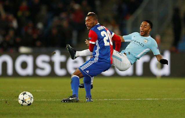 Soccer Football - Champions League - Basel vs Manchester City - St. Jakob-Park, Basel, Switzerland - February 13, 2018 Manchester City's Raheem Sterling in action with Basel's Serey Die Action Images via Reuters/Andrew Boyers