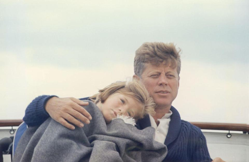 <p>Kennedy huddled close with his daughter Caroline. </p>