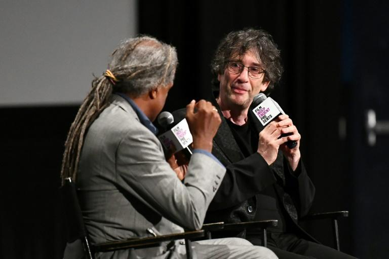 Fantasy author Gaiman, right, asked his Twitter followers to share their experiences of being warm to help inspire his poem