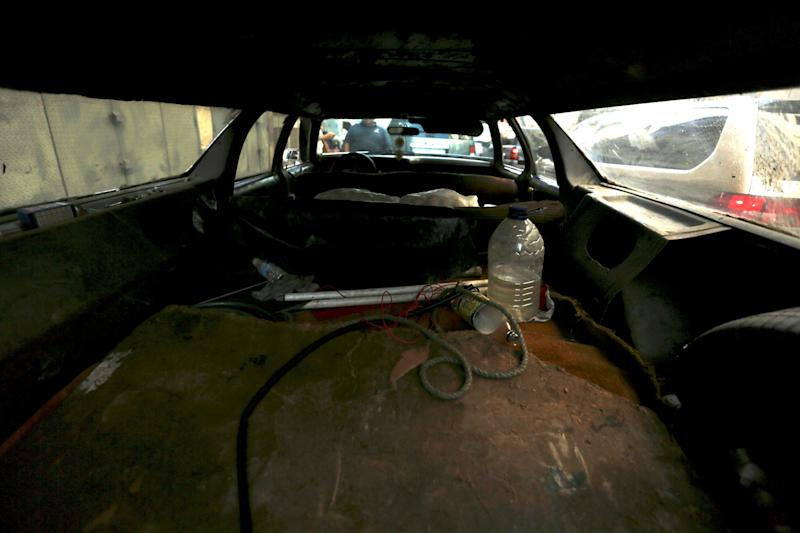 """This Thursday, Dec. 19, 2013 photo shows the back interior of Ruben Ruiz's station wagon at a taxi stand in Caracas, Venezuela. Ruiz is the proud owner of one a 1975 Ford LTD station wagon that he affectionately nicknamed his """"poverty spook,"""" because the go-anywhere vehicle keeps him gainfully employed transporting everything from eight passengers at a time to crates of fresh fruit. Once his load even included a cadaver. (AP Photo/Fernando Llano)"""