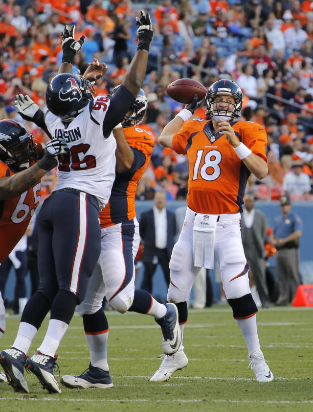 Denver Broncos quarterback Peyton Manning (18) throws under pressure against the Houston Texans during the first half of an NFL preseason football game, Saturday, Aug. 23, 2014, in Denver. (AP Photo/Jack Dempsey)