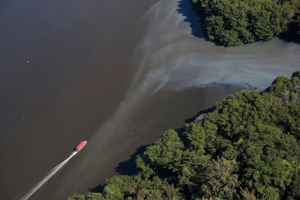"""<p>In this July 5, 2016 photo, an aerial view shows sewage moving into the canals that rim the Barra de Tijuca neighborhood near Olympic Park in Rio de Janeiro, Brazil. While local authorities including Rio Mayor Eduardo Paes have acknowledged the failure of the city's water cleanup efforts, calling the """"lost chance"""" a """"shame,"""" Olympic officials continue to insist Rio's waterways will be safe for athletes and visitors. (AP Photo/Felipe Dana)</p>"""