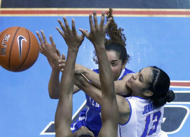 Kentucky guard Jennifer O'Neill, left, passes under pressure from DePaul guard Chanise Jenkins (13) and Jasmine Penny during the second half of an NCAA college basketball game Thursday, Dec. 12, 2013, in Chicago. Kentucky won 96-85. (AP Photo/Charles Rex Arbogast)
