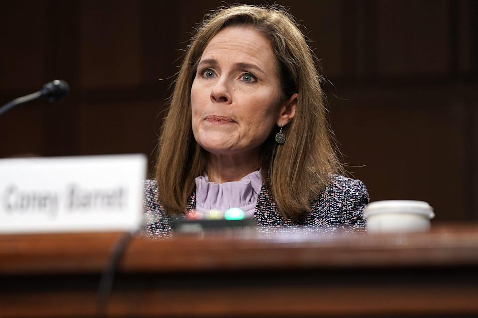 Supreme Court nominee Judge Amy Coney Barrett appears before the Senate Judiciary Committee on the third day of her Supreme Court confirmation hearing on Capitol Hill on 14 October 2020 (Getty Images)