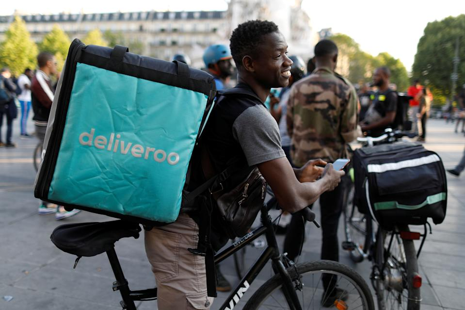 A biker, wearing a Deliveroo food courier backpack, demonstrates during a call on clients to boycott the brand in Paris, France, August 7, 2019.  REUTERS/Charles Platiau