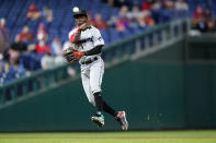 Miami Marlins second baseman Jazz Chisholm Jr. throws to first after fielding a ground out by Philadelphia Phillies' Jean Segura during the fifth inning of baseball game, Tuesday, May 18, 2021, in Philadelphia. (AP Photo/Matt Slocum)