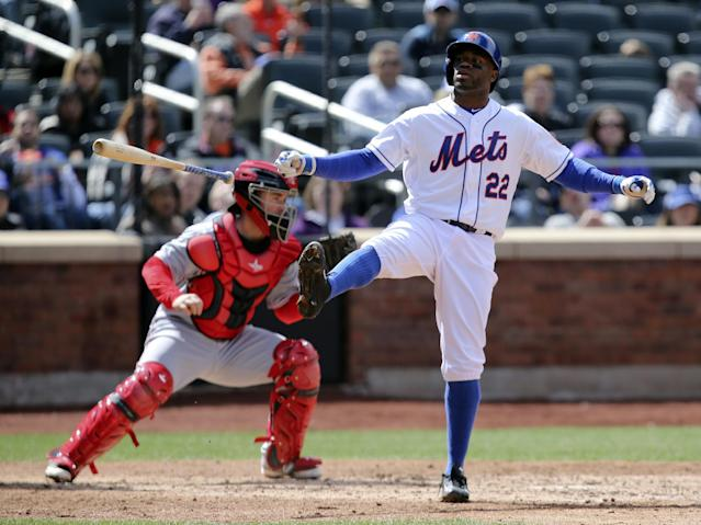 New York Mets left fielder Eric Young Jr. (22) reacts after striking out in the fifth inning of a baseball game against the Cincinnati Reds at Citi Field, Saturday, April 5, 2014, in New York. (AP Photo/John Minchillo)
