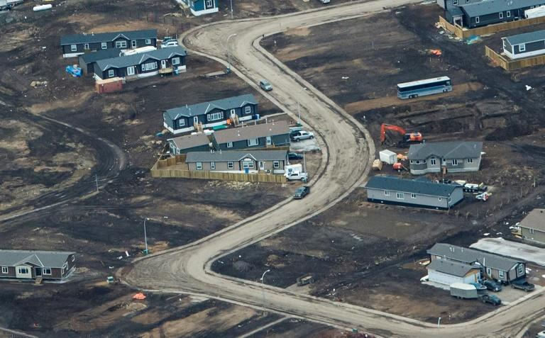 Aerial view of a residential neighborhood in Fort McMurray, Canada, where some homes have been rebuilt but many have not, one year after a massive forest fire