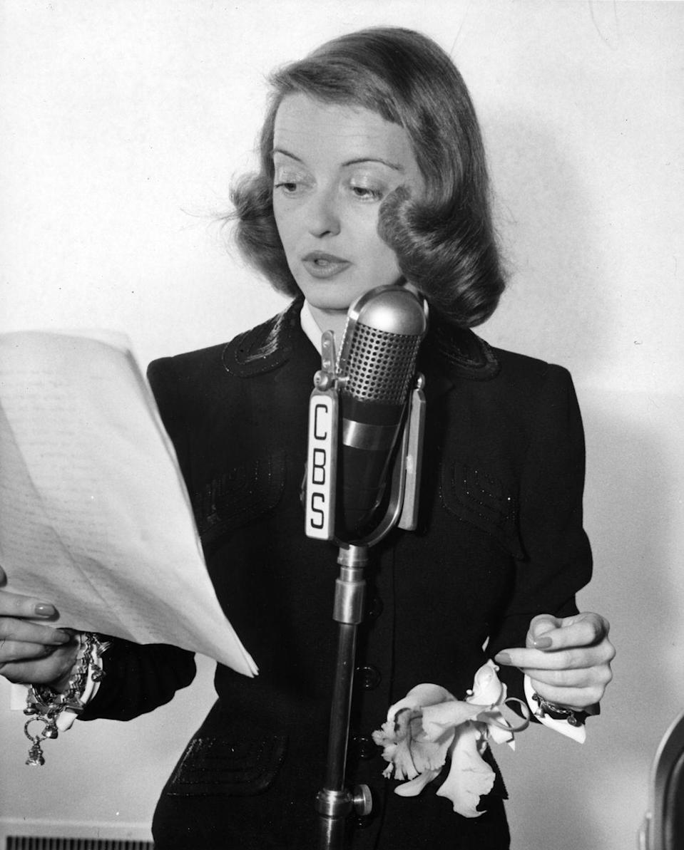 <p>1940 brought Davis's most commercially successful project to date, the Warner Bros. drama <em>All This, And Heaven Too</em>. Here, Davis is pictured performing a radio version of her role.<br></p>